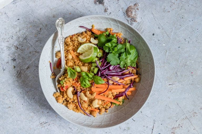 one serving of instant pot thai curry quinoa salad in a blue ceramic bowl