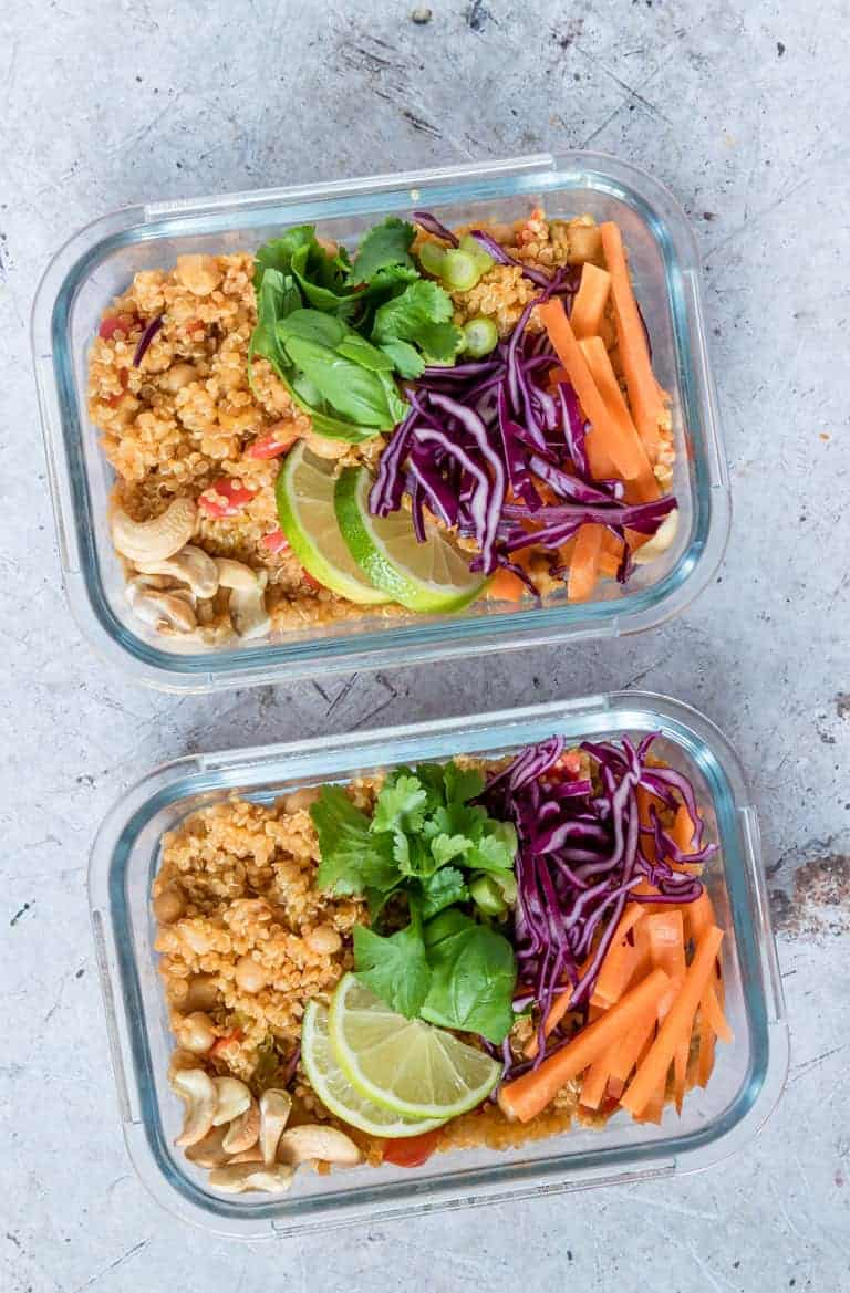 two meal prep glass containers filled with instant pot thai curry quinoa salad