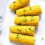 Instant Pot Corn on the Cob garnished with lime zest, cilantro and salt and ready to be served