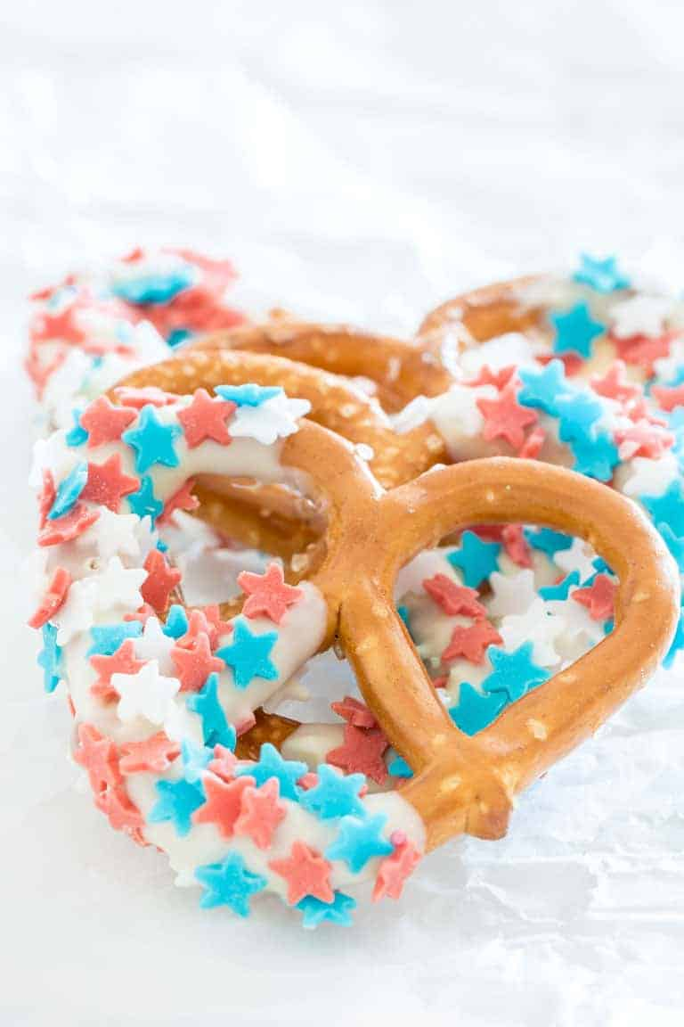 three chocolate covered pretzels decorated with patriotic candy stars