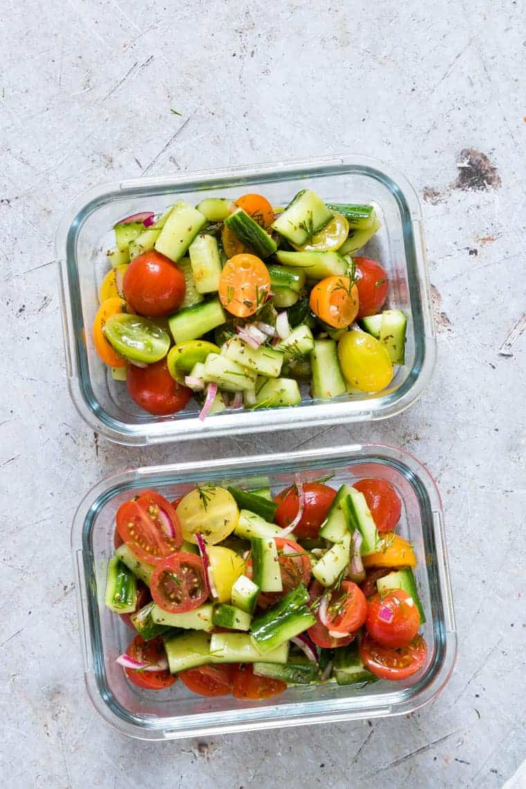 two servings of salad packed in glass meal prep containers