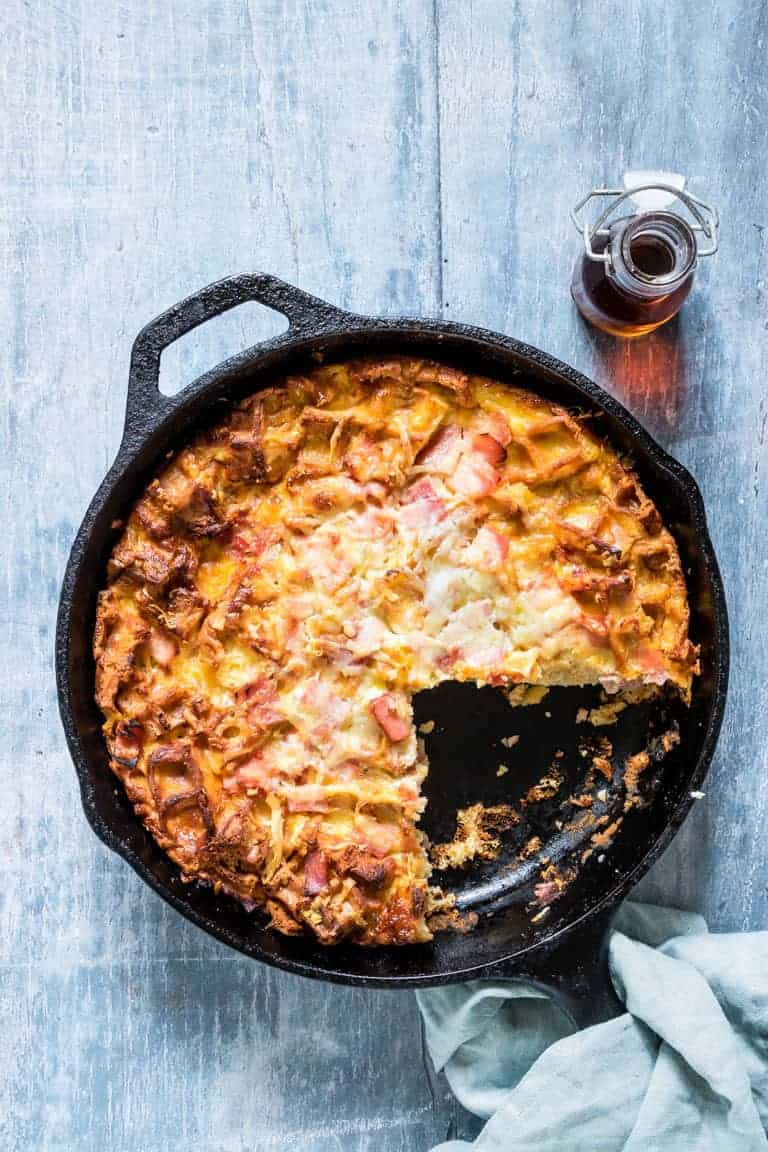 Cheesy Waffle and Ham Breakfast Casserole in the skillet with one serving removed