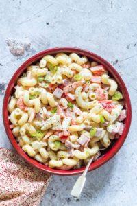 Hawaiian Macaroni Salad served in a red bowl