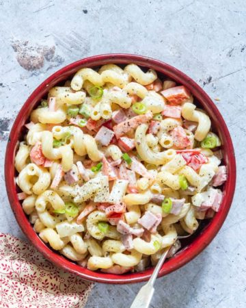 Hawaiian Macaroni Salad served in a red bowl