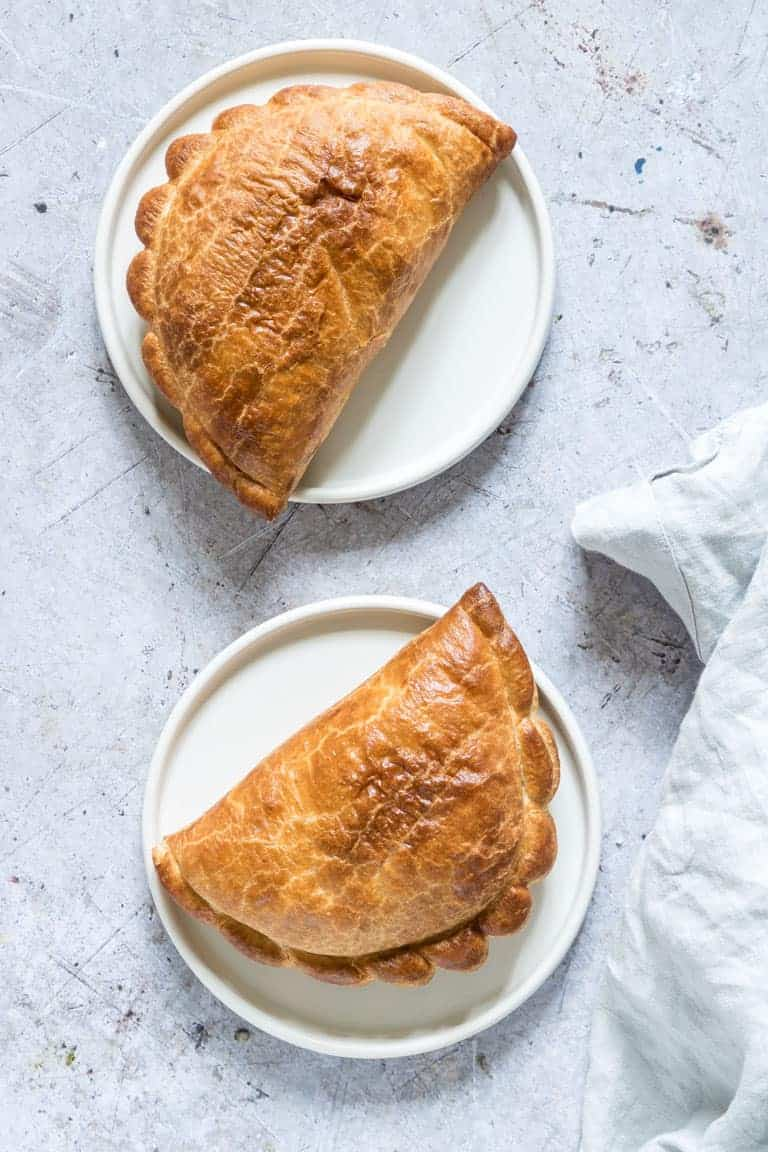 two cornish pasties served on white plates