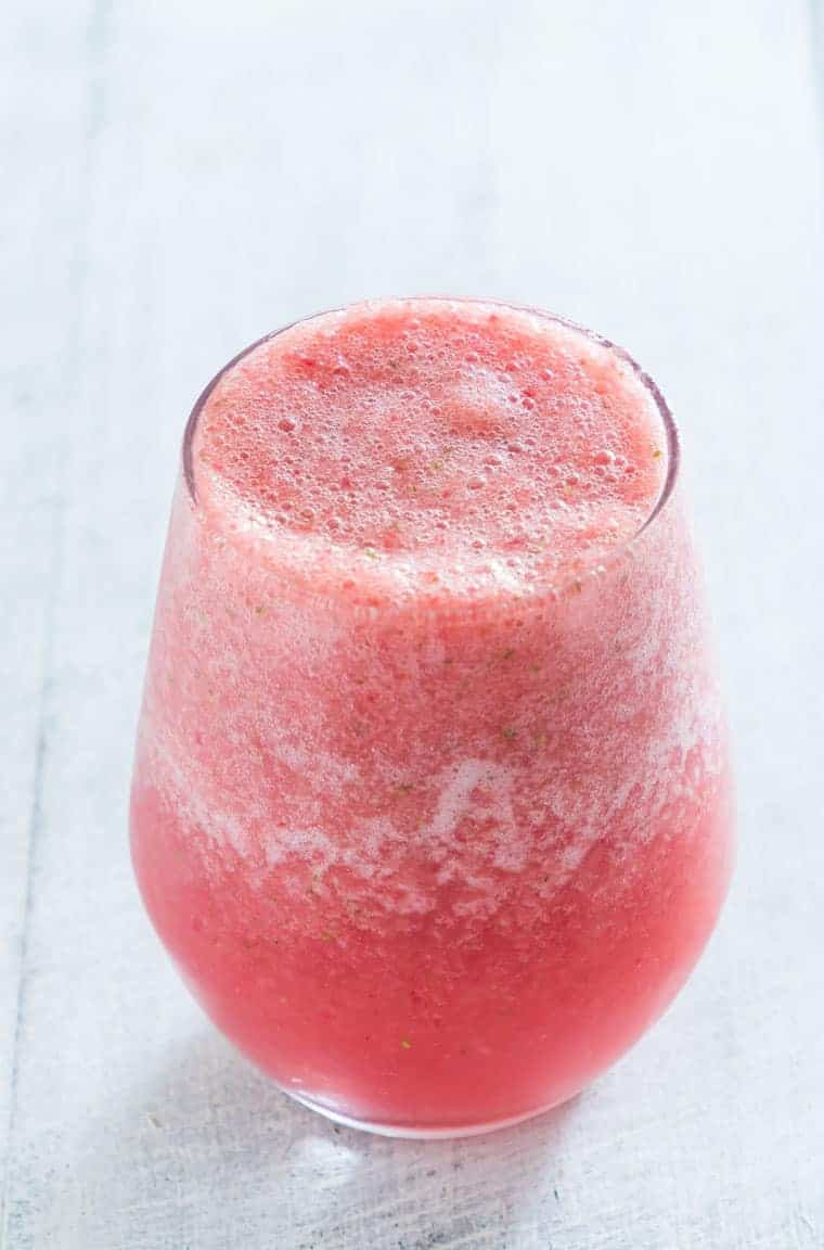 close up view of a glass filled with strawberry watermelon smoothie