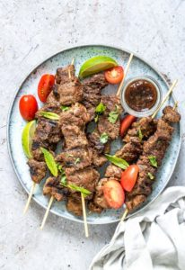 grilled lamb kabobs served with salad