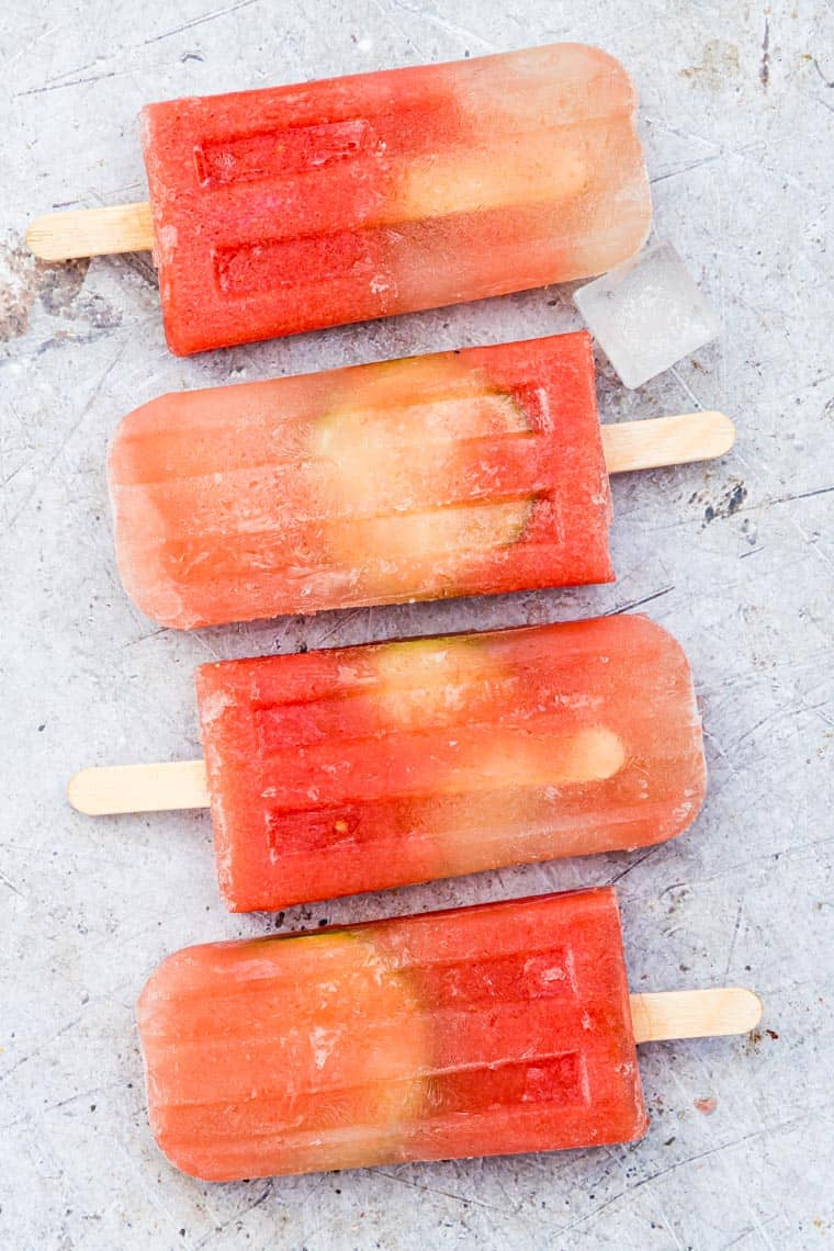 boozy popsicles with margarita on a table